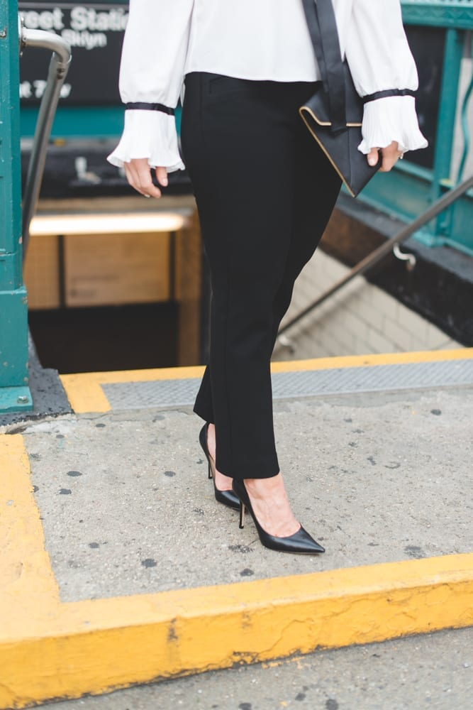 In between NYFW shows, blogger, Ashley Pletcher, hops off the NYC subway wearing affordable fashion with an Asos ruffle top with Express pants and Jimmy Choo Pumps!