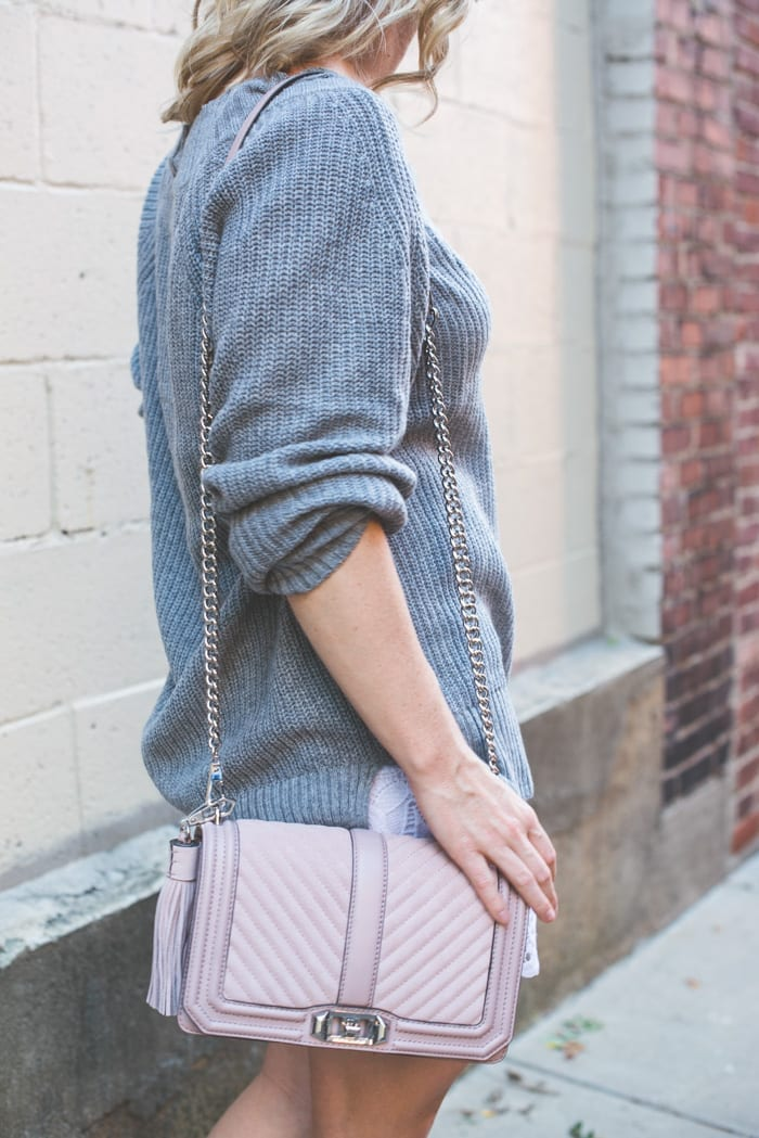 Blogger, Ashley Pletcher, shares her Fall transition pieces with the cozies grey sweater and this beautiful pink Rebecca Minkoff bag.
