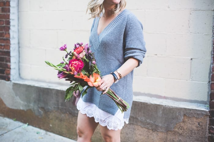 Fashion Blogger, Ashley Pletcher runs to the market in Pittsburgh for some fresh Autumn florals in an Abercrombie & Fitch summer skirt with some black booties and a Nordstrom deep v-neck sweater, and a classic Daniel Wellington watch.