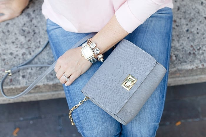 Blogger, Ashley Pletcher loves pairing grey and soft pink with her Mint Julep Fall tunic and this Gigi New York cross body bag!