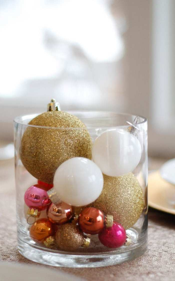 Spreading Christmas cheer with a simple, but festive ornament filled vase for the perfect centerpiece.