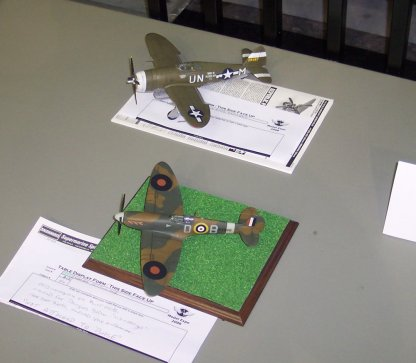 A P-47 and Spitfire.