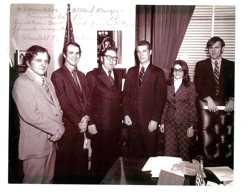 At a bill signing in the early 1970s, Gov. Wendell Anderson is surrounded by framers of historic environmental legislation. From left: Environmental lobbyists Chuck Dayton and John Herman, Rep. Willard Munger, chief author of many environmental bills, Gov. Anderson, Jackie Rosholt (Munger's aide) and Peter Gove, Governor's environmental aide.