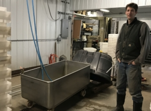 Janaki Fisher-Merritt shows off the equipment in his modern root cellar. Photo: SH