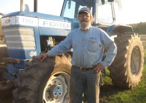 Tom Cogger has learned to be a mechanic as well as an animal husbandman and soil expert at his Maple Hill Farm. Photo courtesy Tom Cogger