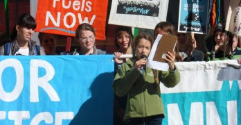 Olya Wright speaking at youth rally and march for climate change action