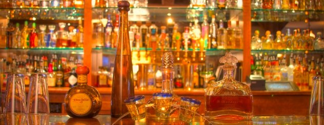 A photo of tequila on a bar.