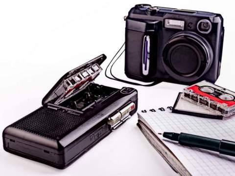 Old writer or reporter equipment, dictaphone, camera etc.