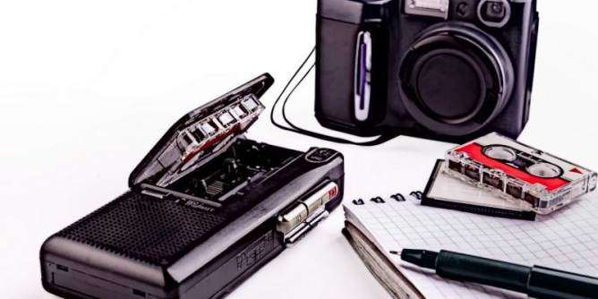 Old writer or reporter equipment, dictaphone, camera etc.