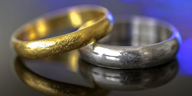 Gold Ring and Platinum Ring. One is Ruling.