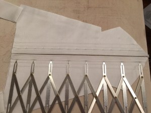 Marking eyelet placement with an expanding ruler.