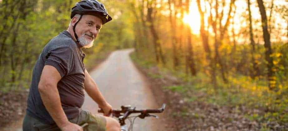 older man engaging in his hobby of cycling