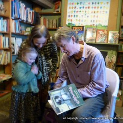 Magdalena listens to Malachy Doyle read and gets her book signed by him