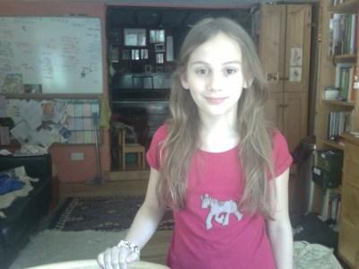 Agi K wearing the T-shirt she made