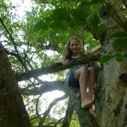 Me climbing (barefoot!) up into a branch