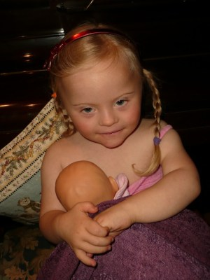 3 year old Magdalena giving her dolly breast milk
