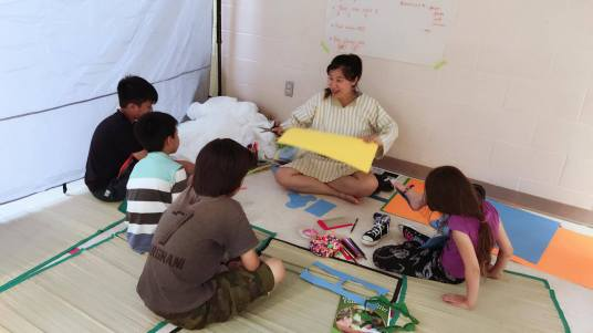 Joyce Chow teaching a group in the Marketplace
