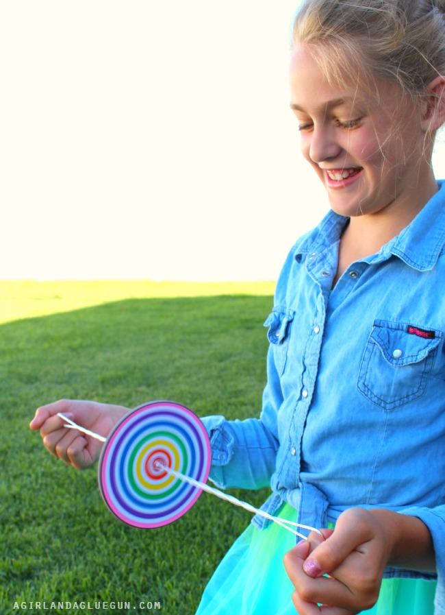 DIY Paper Spinners fun kids craft for summer via Make and Takes
