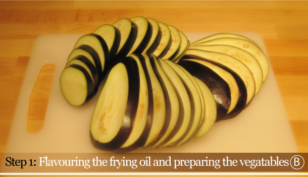 Parmigiana di Melanzane - Aubergine Parmigiana Pie - How to - step 1B - Flavouring the frying oil and preparing the vegetables