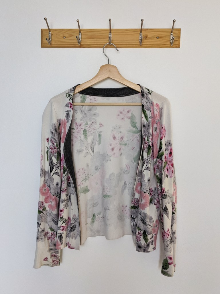 An old floral sweater upcycled into a cardigan