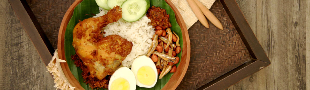 Dish of Malaysian chicken with rice and egg at upscale restaurant in Kuala Lumpur, Malaysia