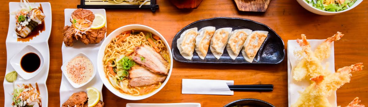 Tokyo food-Featured photo (1200x350) table of Japanese food or buffet