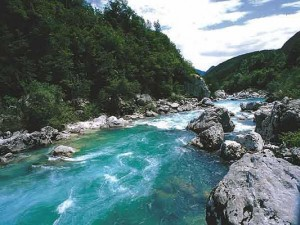 God is a flowing stream of water of life, and He rules in us by watering us and giving us to drink [picture source: a flowing river]