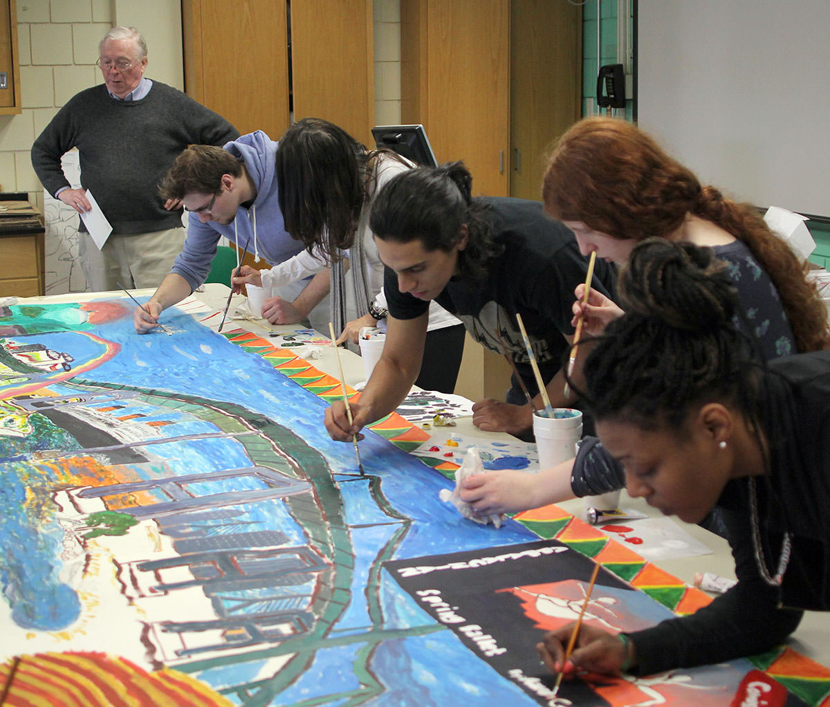 James Chisholm and students from his NSCC drawing class working on the mural