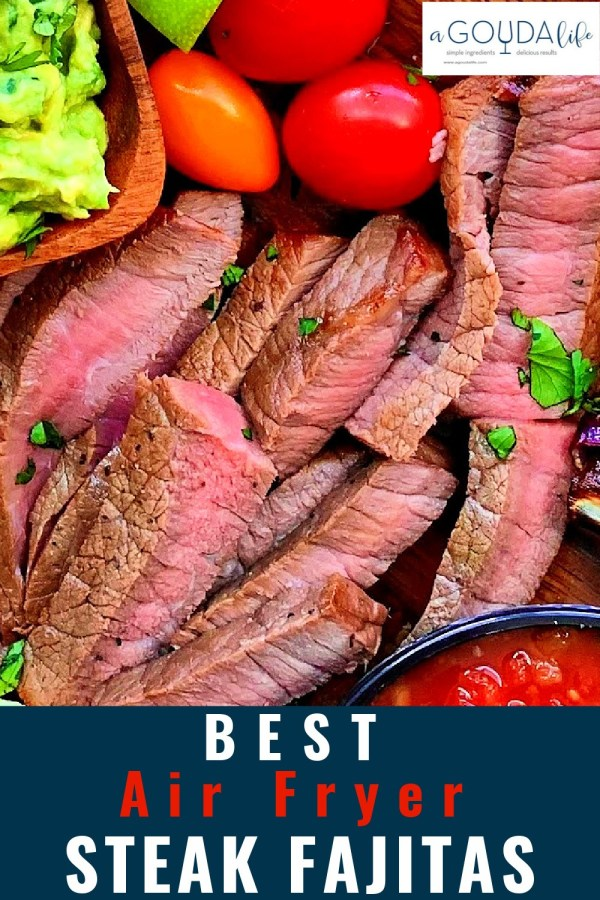 pinterest pin - closeup of medium rare sliced steak on a board with guacamole and air fryied vegetables