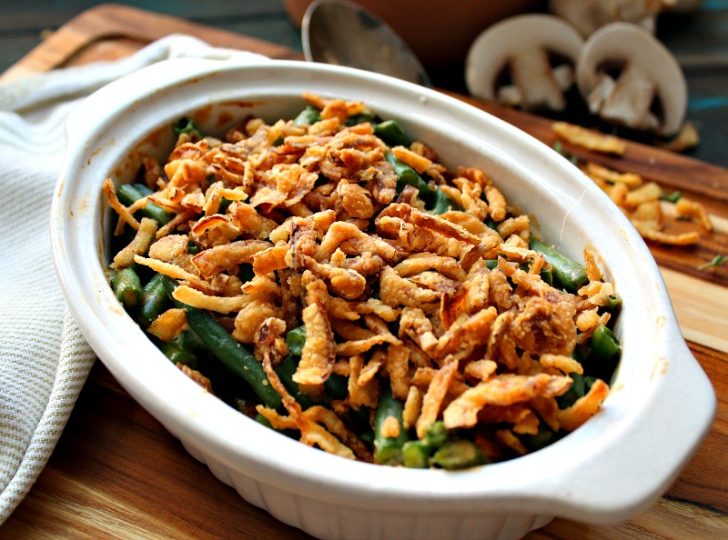 white casserole dish with green bean casserole topped with French's fried onions
