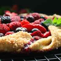 Close up of baked galette showing browned crust with coarse sugar