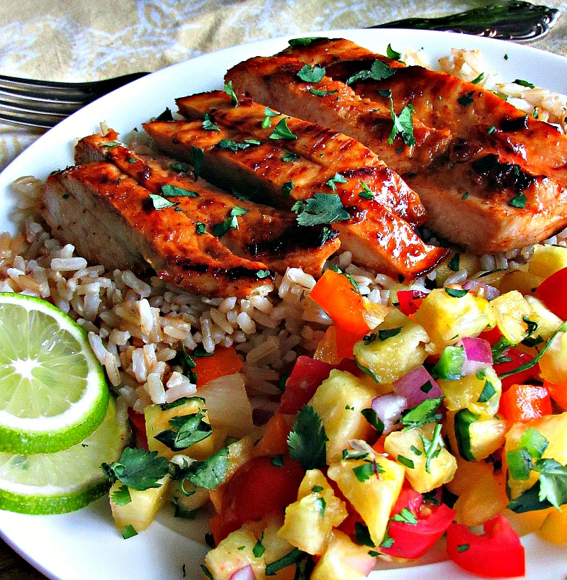 plate of sliced chicken and side of pineapple salsa