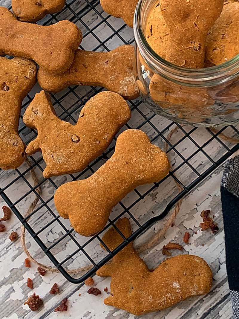 bone and squirrel shaped dog treats on wire baking rack