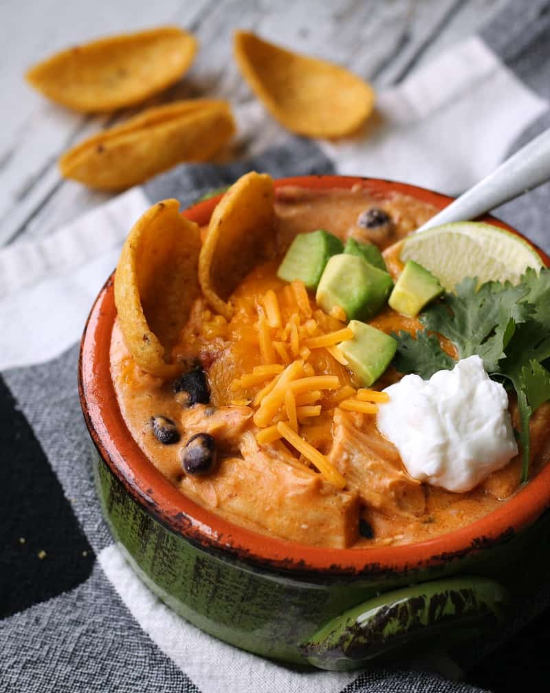 overhead view - bowl of soup topped with extra cheese and sour cream