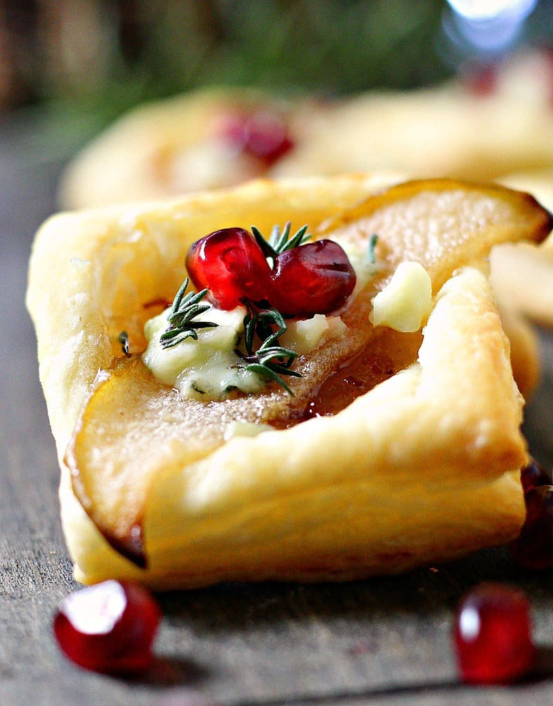 Pear Blue Cheese Puff Pastry Bites ~ golden puff pastry + maple bacon onion jam, caramelized pears and blue cheese. A simple, elegant holiday appetizer.