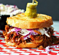 slow cooker bbq pulled chicken on texas toast with pickle slices