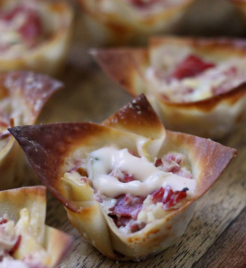reuben wonton cupcakes ~ corned beef, kraut, cheese and thousand island dressing baked in a mini wonton cup