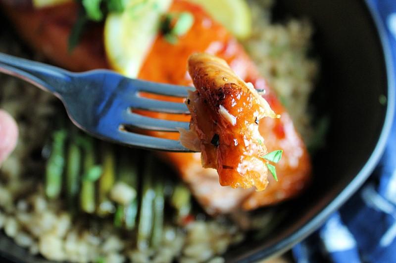 bite of glazed salmon on fork