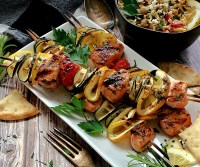 grilled salmon skewers on white plate