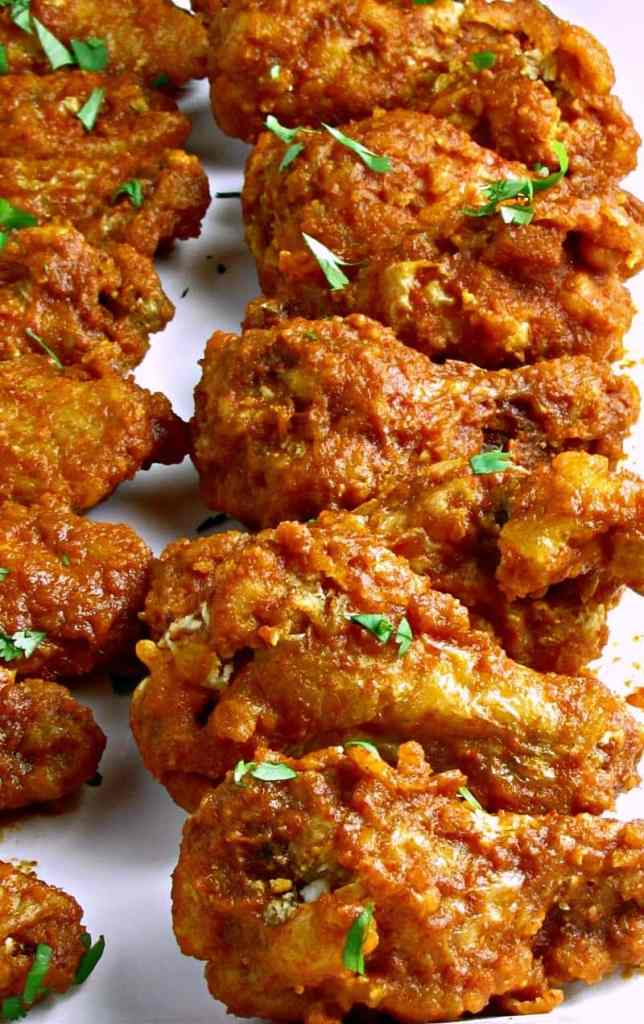 Ultimate Spicy Chicken Wings: light, crispy breading, unique hot/tangy sauce for a flavor that keeps 'em coming back for more.