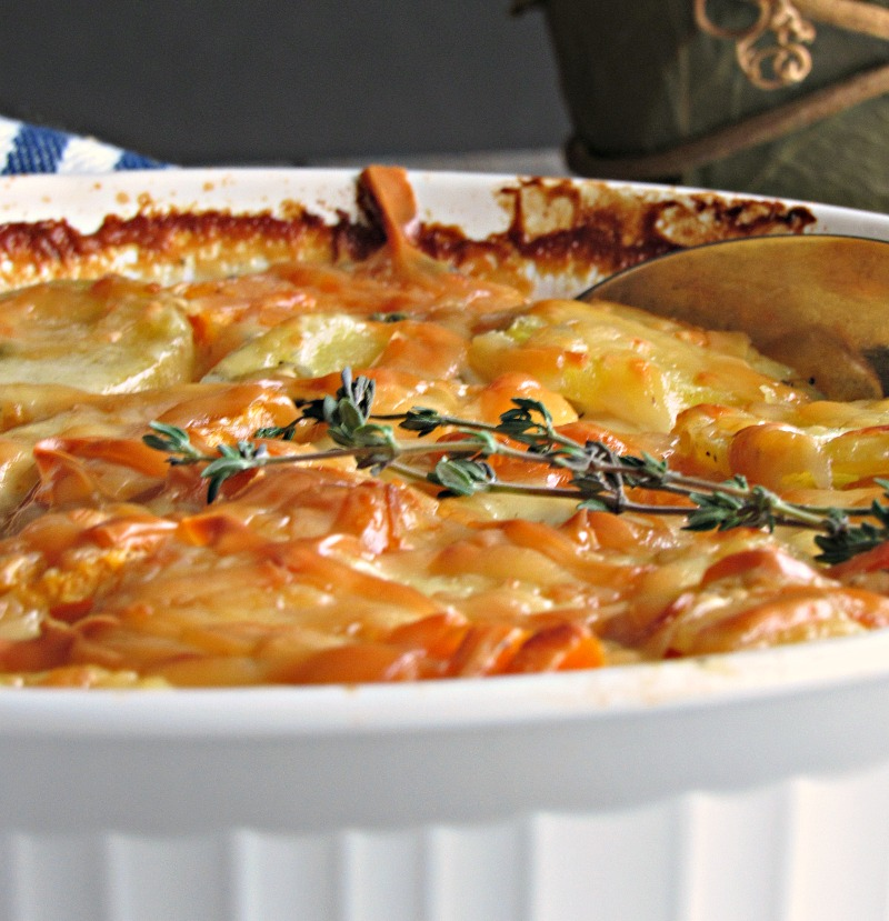 Yukon Gold Sweet Potato Au Gratin ~ thinly sliced sweet & Yukon gold potatoes topped with gruyere cheese + fresh thyme in a delicious creamy, silky sauce.