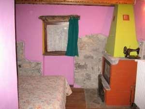 Camera 13 - Dettaglio Caminetto