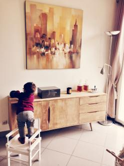 toddler standing on the chair