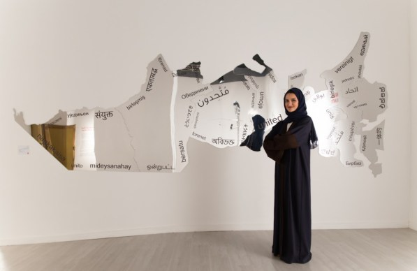 "Artist Amna Al Dabbagh with her piece, ""United."" Photo courtesy of Chiragh Bhatia."