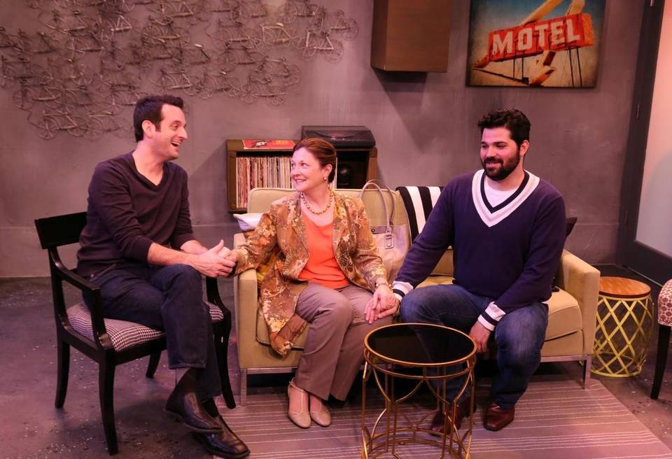 Antonio Amadeo (left) and Alex Alvarez make the best of a visit by Laura Turnbull to their home in the Island City Stage world premiere 'Daniel's Husband.' | ROBERT FIGUEROA ROBERT FIGUEROA