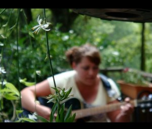 """""""Artsy-fartsy"""", out-of-focus shot of me playing on the front porch at Big Creek."""