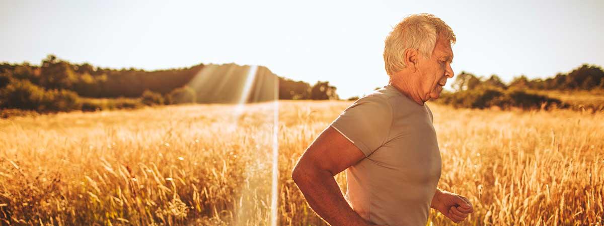 Man jogging by field