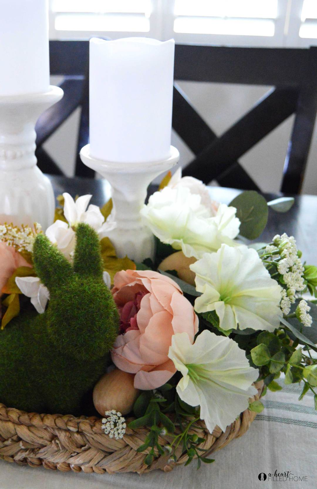How to create a budget friendly Spring centerpiece! By using neutral decor and artificial flowers from Dollar Tree I was able to create this beautiful centerpiece on a budget!