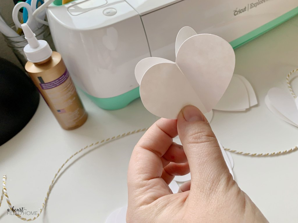 How To Make An Easy DIY Valentine's Day Garland with paper hearts! from aheartfilledhome.com
