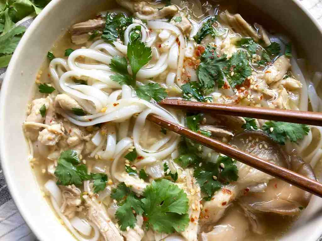 feel-good chicken soup with ginger over rice noodles